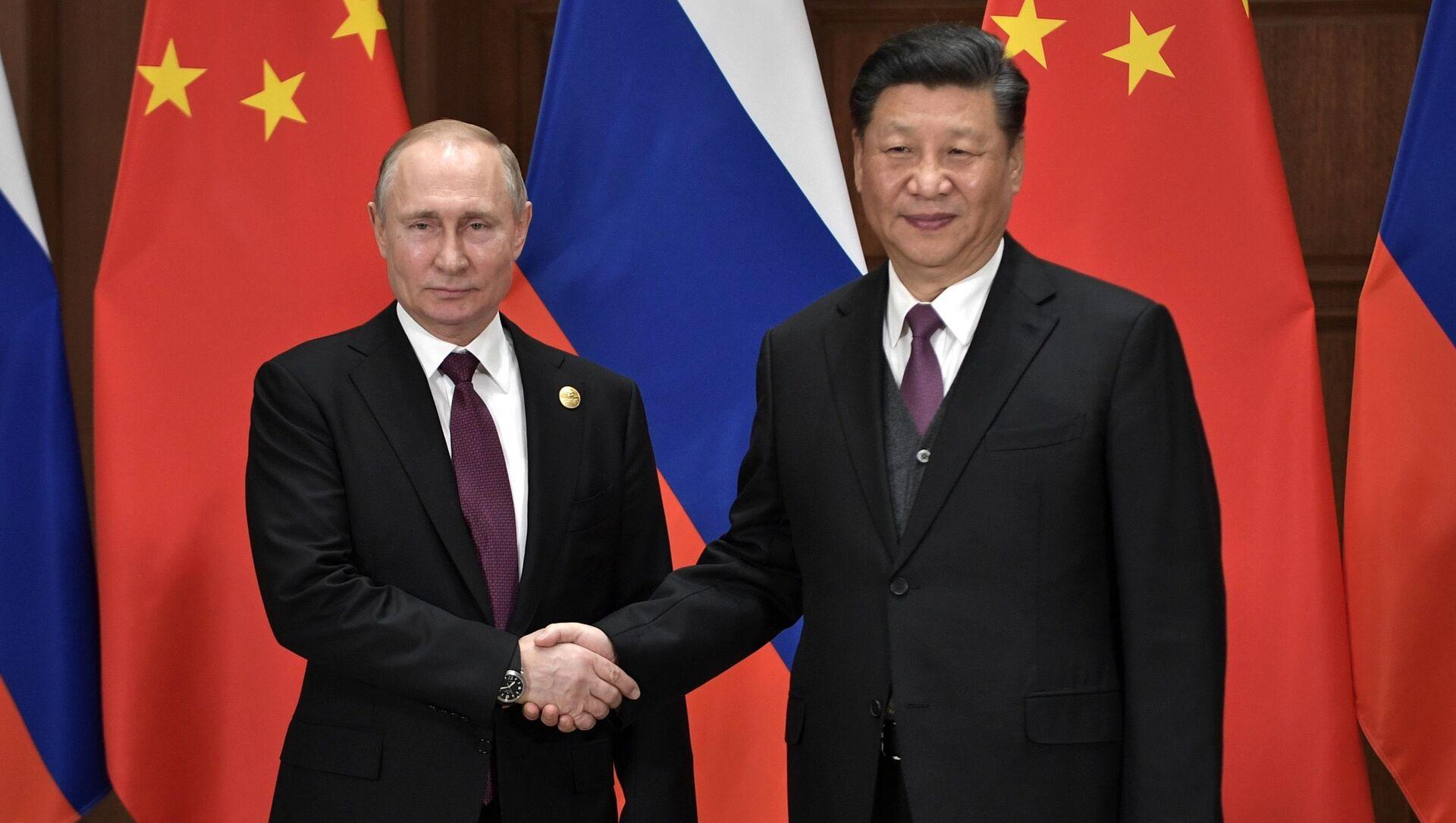 Tổng thống Nga Vladimir Putin  và Chủ tịch Trung Quốc Tập Cận Bình - Sputnik Việt Nam, 1920, 18.05.2021