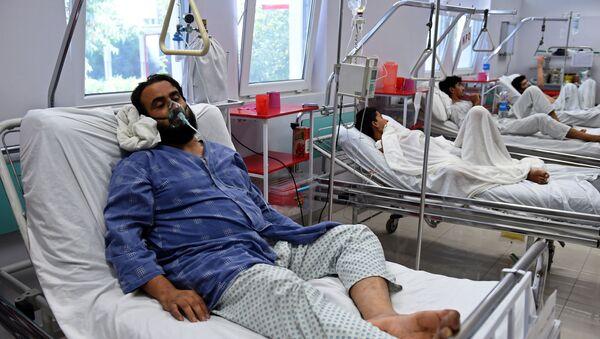 Nhân viên bệnh viện bị thương trong vụ bắn phá  ở thành phố  Kunduz, Afghanistan - Sputnik Việt Nam