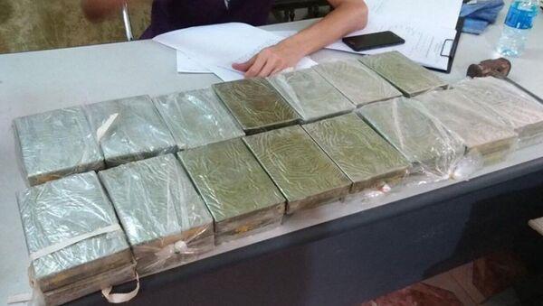 Tang vật thu giữ gồm 30 bánh heroin - Sputnik Việt Nam
