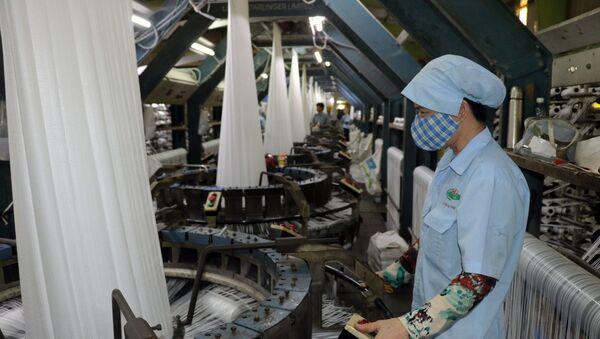 EVFTA sẽ có tác động tích cực đến dệt may Việt Nam trong dài hạn bởi 42,5% dòng thuế áp dụng đối với dệt may Việt Nam sẽ giảm về 0%.  - Sputnik Việt Nam