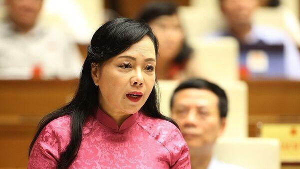 Bộ trưởng Bộ Y tế Nguyễn Thị Kim Tiến giải trình làm rõ một số vấn đề đại biểu Quốc hội quan tâm.  - Sputnik Việt Nam