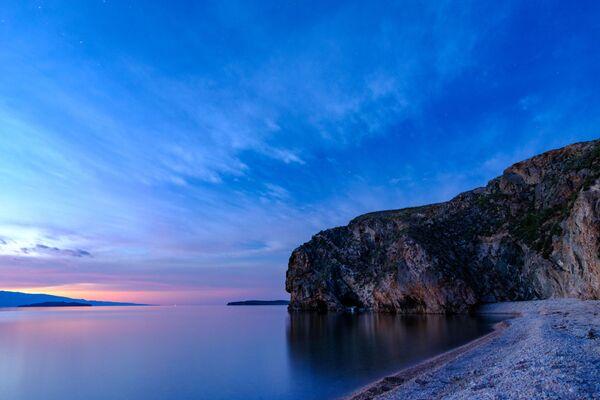Hoàng hôn nhìn từ đảo Olkhon trên hồ Baikal, tỉnh Irkutsk - Sputnik Việt Nam