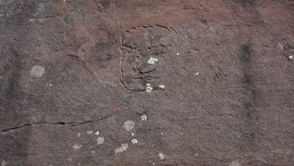 Các nhà khoa học tìm thấy hình Đức Phật khắc trên đá ở Siberia - Sputnik Việt Nam