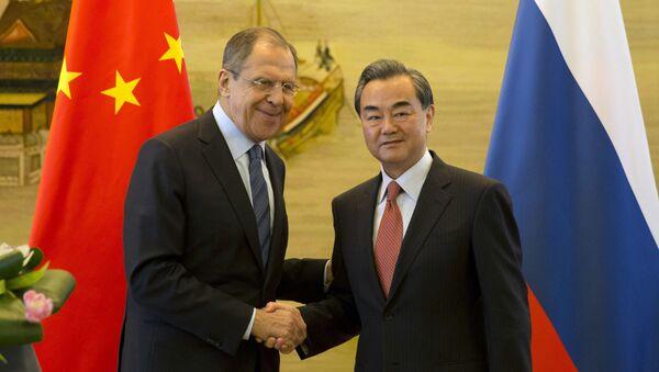 Ngoại trưởng Nga Sergei Lavrov và người đồng cấp Trung Quốc Vương Nghị - Sputnik Việt Nam
