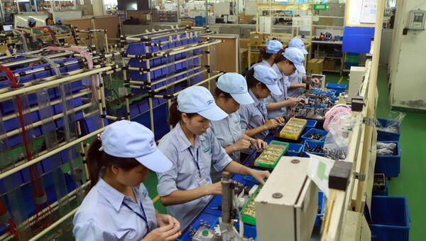 Hoạt động sản xuất tại Công ty TNHH Công nghiệp Minda Việt Nam (khu công nghiệp Bình Xuyên) - Sputnik Việt Nam