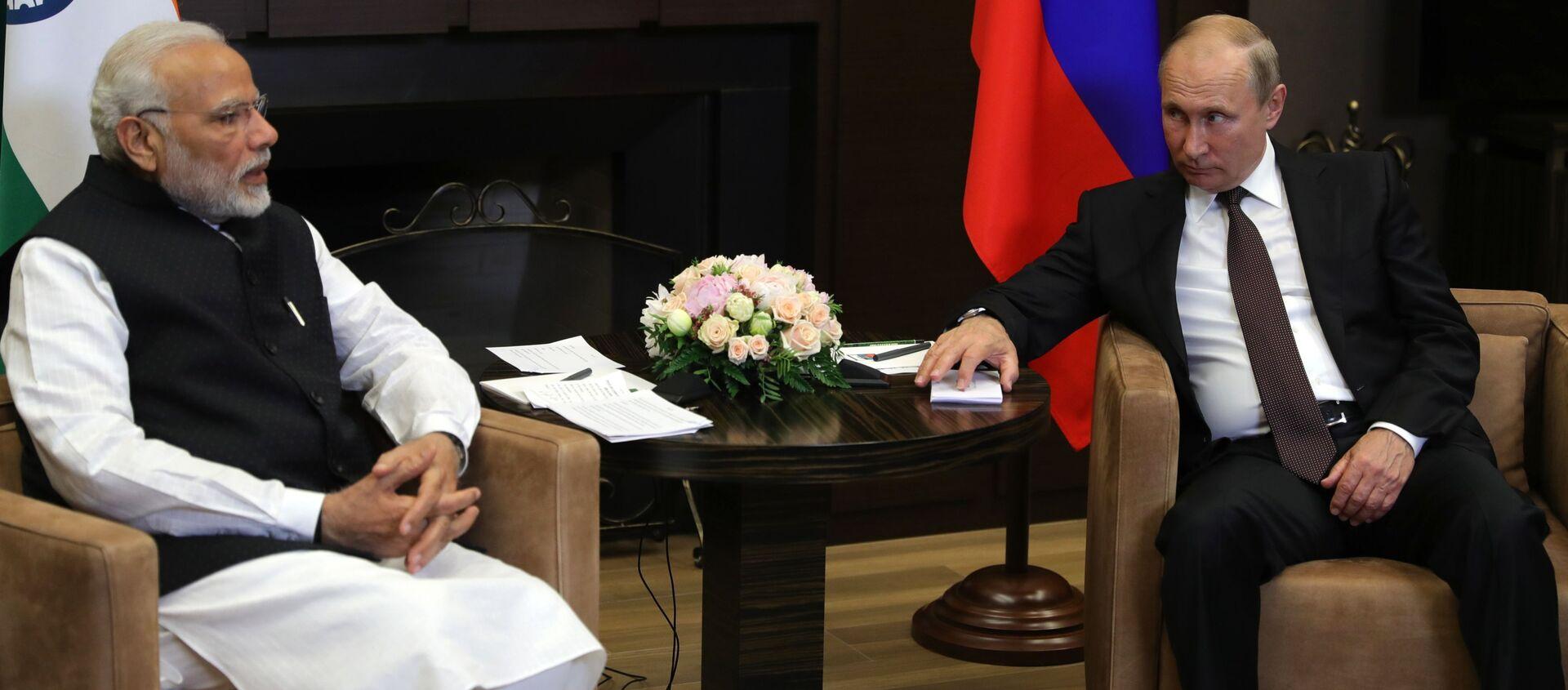 Tổng thống Nga Vladimir Putin và Thủ tướng Ấn Độ Narendra Modi trong một cuộc họp - Sputnik Việt Nam, 1920, 04.09.2019