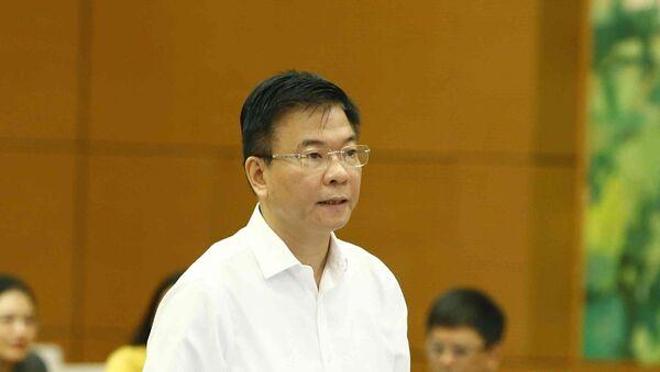 Bộ trưởng Bộ Tư pháp Lê Thành Long trình bày báo cáo. - Sputnik Việt Nam