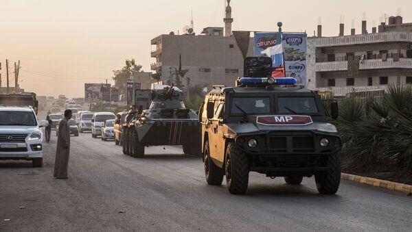 Quân cảnh Nga tuần tra thành phố Amuda, phía bắc Syria - Sputnik Việt Nam