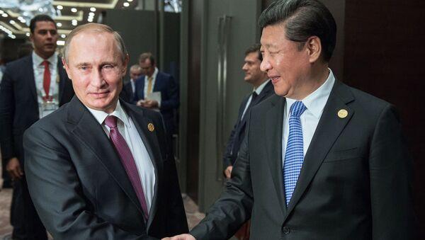 Tổng thống Nga Vladimir Putin và Chủ tịch Trung Quốc Tập Cận Bình tại hội nghị thượng đỉnh G20 ở Thổ Nhĩ Kỳ - Sputnik Việt Nam