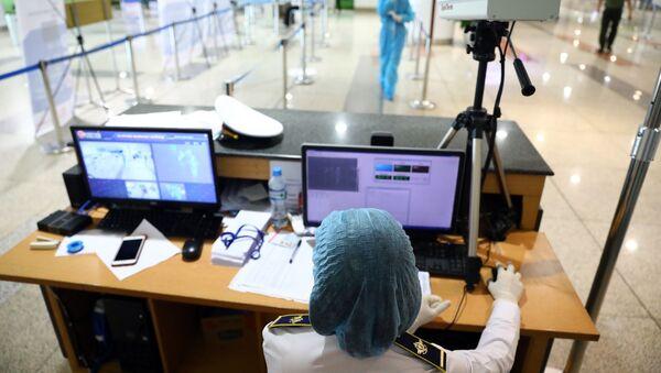 Khu kiểm tra thân nhiệt tại sân bay Nội Bài. - Sputnik Việt Nam
