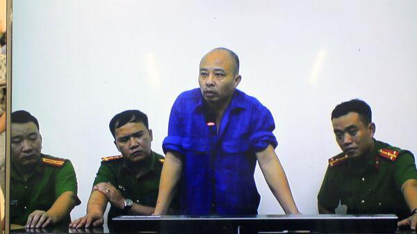 Tại phiên xử Nguyễn Xuân Đường (còn gọi là Đường Nhuệ) được triệu tập đến tòa nhưng bố trí ở một phòng khác trả lời trực tuyến hội đồng xét xử.  - Sputnik Việt Nam