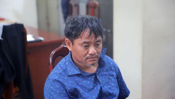Nghi can Đỗ Văn Minh tại cơ quan công an - Sputnik Việt Nam