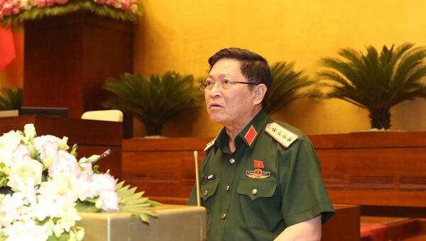 Bộ trưởng Bộ Quốc phòng Ngô Xuân Lịch giải trình ý kiến của đại biểu Quốc hội. - Sputnik Việt Nam