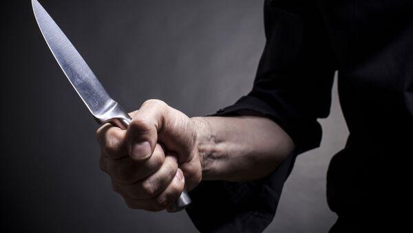 Người đàn ông cầm dao - Sputnik Việt Nam